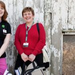 Welsh Mountain medical visit- two women standing against barn