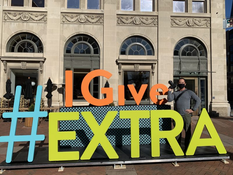 8 foot tall colorful letters spelling #IGiveExtra in Penn Square